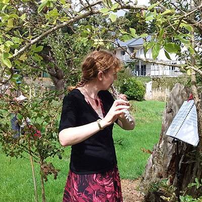 Flautist in the orchard