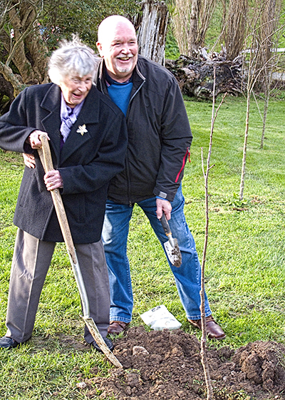 Jean and Adrian Liner planting Montmorency cherry tree