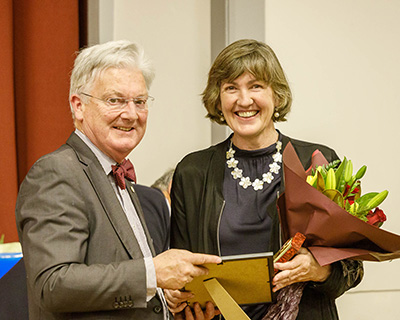 Peter Dunne presenting Claire with North Wellington Voluntary Services Award