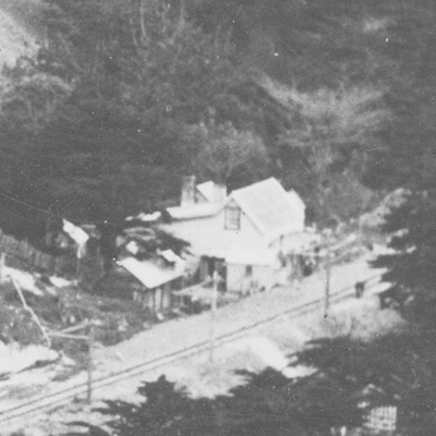 Detail of Woodlands, the Broderick house, during railway construction.